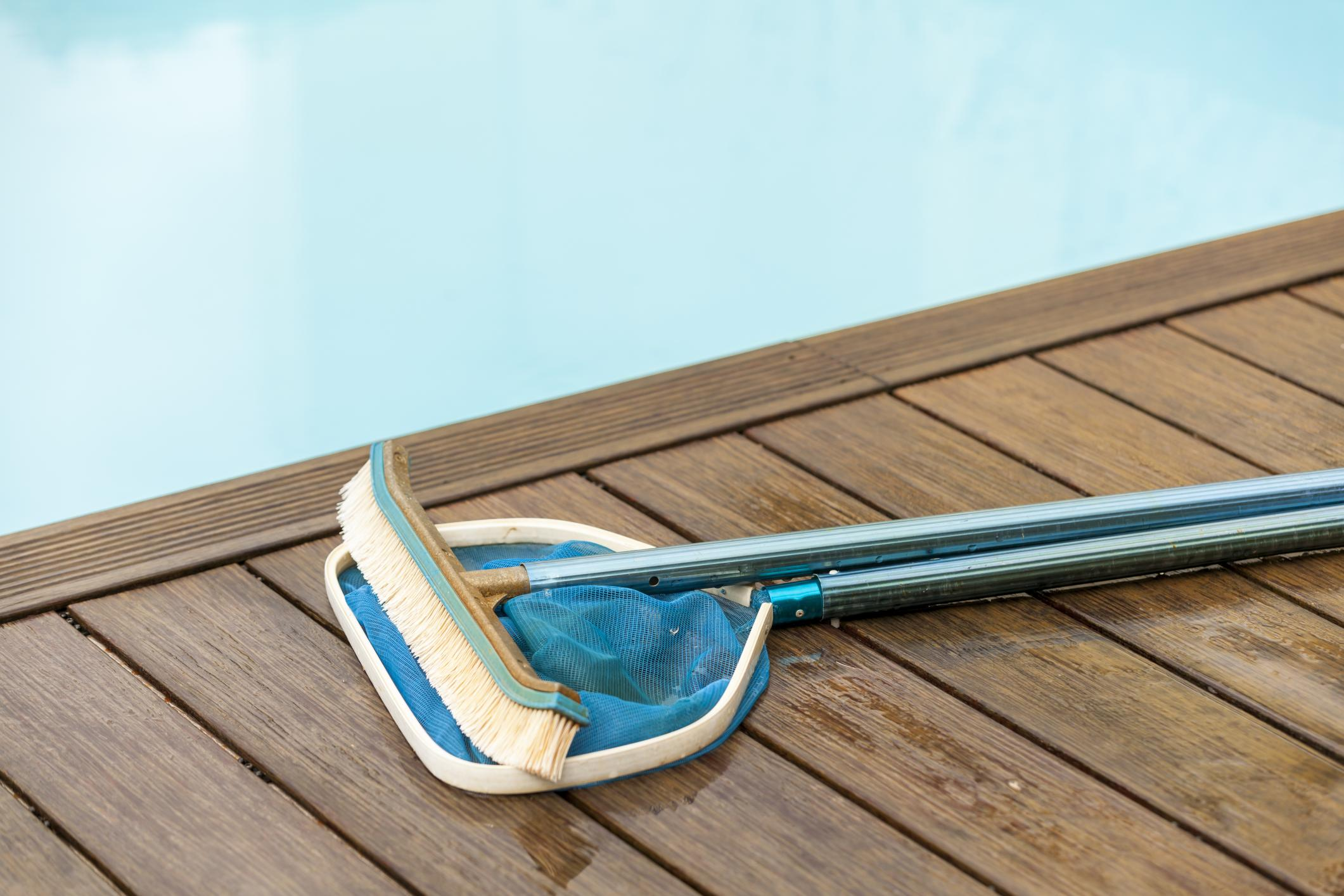 pool cleaning tools left beside the pool